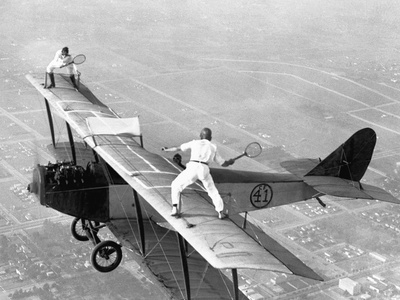 Daredevils Playing Tennis on a Biplane Fotoprint
