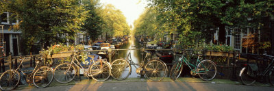 Bicycles on Bridge Over Canal, Amsterdam, Netherlands Photographic Print by  Panoramic Images