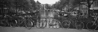 Bicycle Leaning Against a Metal Railing on a Bridge, Amsterdam, Netherlands Photographic Print by  Panoramic Images