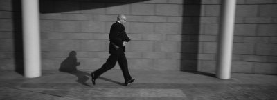 Side Profile of a Businessman Running with a Briefcase, Germany Photographic Print by  Panoramic Images
