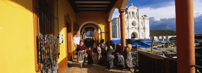 Group of People Walking in a Corridor, San Francisco El Alto, Guatemala Photographic Print by  Panoramic Images