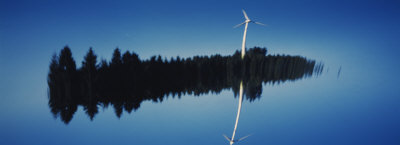 Reflection of a Wind Turbine and Trees on Water, Black Forest, Germany Photographic Print by  Panoramic Images