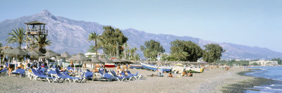 Tourists on the Beach, San Pedro, Costa Del Sol, Marbella, Andalusia, Spain Photographic Print by  Panoramic Images
