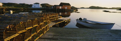 Stack of Lobster Traps at a Dock, Change Islands, Newfoundland and Labrador, Canada Photographic Print by  Panoramic Images