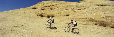 Two Men Mountain Bilking on Rocks, Slickrock Trail, Moab, Utah, USA Photographic Print by  Panoramic Images