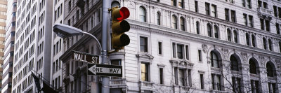 Traffic Light in Front of a Building, Wall Street, New York, USA Photographic Print by  Panoramic Images