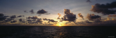 Clouds over the Pacific Ocean at Sunset Photographic Print by  Panoramic Images