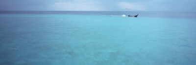 Longtail Boat Floating on Water, Bamboo Island, Thailand Photographic Print by  Panoramic Images