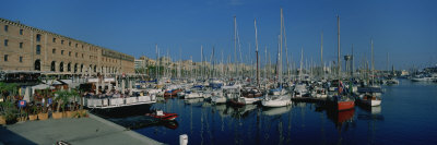 Sailboats at a Harbor, Barcelona, Catalonia, Spain Photographic Print by  Panoramic Images