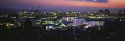 City at a Port Lit Up at Dusk, Genoa, Liguria, Italy Photographic Print by  Panoramic Images