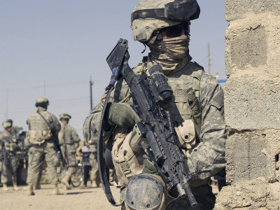 Darwinism Stocktrek-images-us-army-soldier-armed-with-a-mk-48-light-machine-gun-provides-rear-security-during-civil-affairs