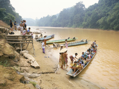 Longboat Crowded with Children Leaving for Week at School, Katibas River, Island of Borneo Photographic Print by Richard Ashworth