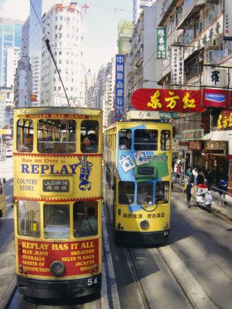 Trams in Wan Chai (Wanchai), Hong Kong, China Photographic Print by Charles Bowman