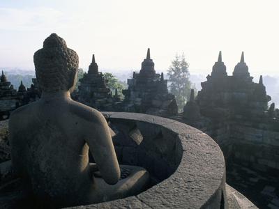 Arupadhatu Buddha, 8th Century Buddhist Site of Borobudur, Unesco World Heritage Site, Indonesia Photographic Print by Bruno Barbier