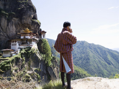 Bhutanese Man with Cell Phone, Taktshang Goemba (Tiger's Nest) Monastery, Paro, Bhutan Photographic Print by Angelo Cavalli