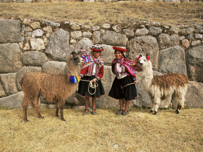 Local Women and Llamas in Front of Inca Ruins, Near Cuzco, Peru, South America Photographic Print by Gavin Hellier