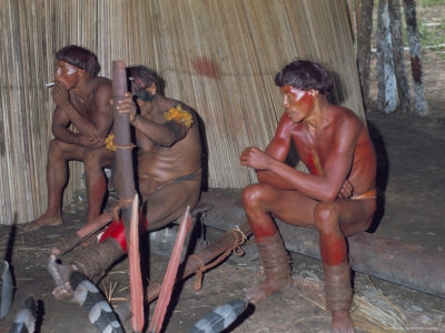 Kamayura Indians Playing Flutes Inside Hut, Xingu Area, Brazil, South America Photographic Print by Robin Hanbury-tenison