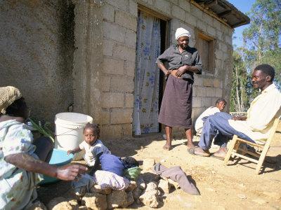 Woman Washing Clothes Outside Shack, Godet, Haiti, Island of Hispaniola Photographic Print by Lousie Murray