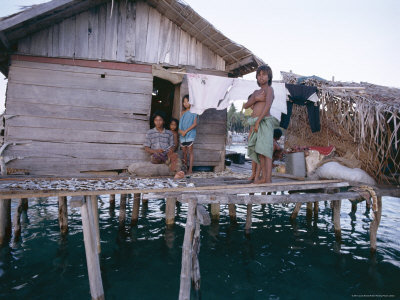 Bajau Family in Stilt House Over the Sea, with Fish Drying on Platform Outside, Sabah, Malaysia Photographic Print by Lousie Murray