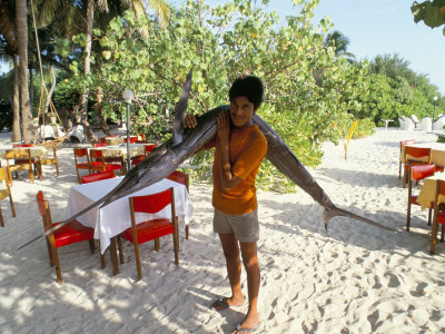 Boy Carrying Freshly Caught Swordfish, Embudu, the Maldives, Indian Ocean Photographic Print by Fraser Hall