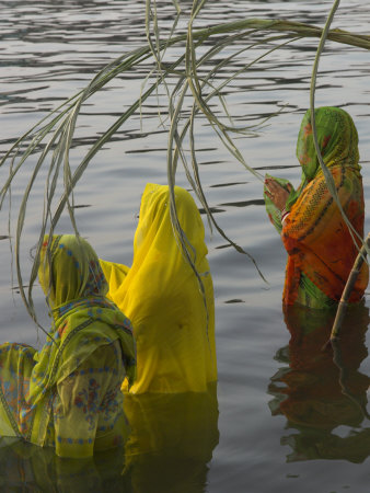 Three Women Pilgrims in Saris Making Puja Celebration in the Pichola Lake at Sunset, Udaipur, India Photographic Print by Eitan Simanor