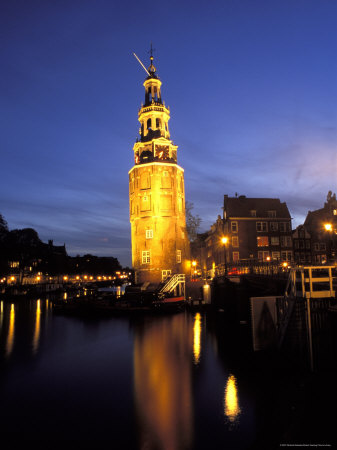 Floodlit Tower at Twilight Reflected in the Canal, Oudeschams, Amsterdam, the Netherlands (Holland) Photographic Print by Richard Nebesky