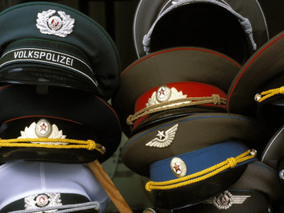 A Pile of Communist Era Army and Police Hats for Sale as Souvenirs, Mitte, Berlin, Germany Photographic Print by Richard Nebesky