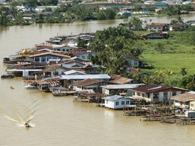 Stilt Houses Along Limbang River, Limbang City, Sarawak, Island of Borneo, Malaysia Photographic Print by Tony Waltham