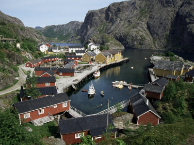 Wooden Red Houses on Stilts Over Water at the Fishing Village of Nusfjord, Lofoten Islands, Norway Photographic Print by Tony Waltham