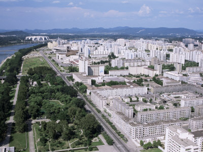 Blocks of Flats Beside Taedong River, Park and Distant Mayday Stadium, Pyongyang, North Korea Photographic Print by Tony Waltham