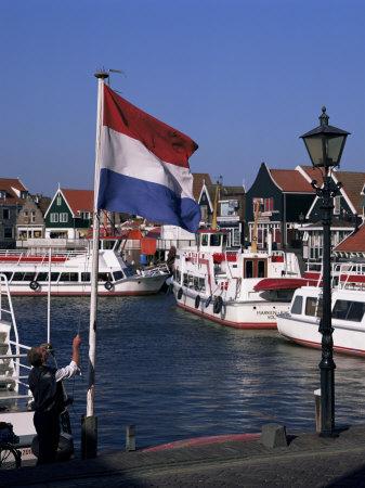 Raising the Dutch Flag by the Harbour, Volendam, Ijsselmeer, Holland Photographic Print by I Vanderharst