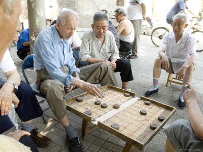 Elderly Men Playing a Form of Chess, Hu Hai Lake, Beijing, China Photographic Print by Adam Tall