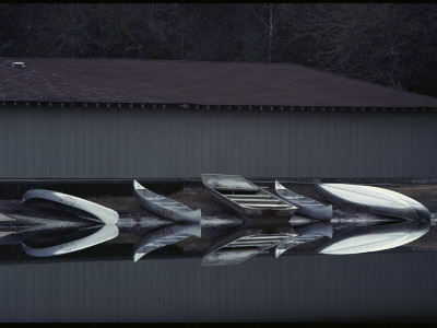 Canoes Reflected in Water at a Boat Landing Photographic Print