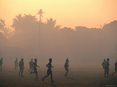 Children Playing Soccer at Sunset, Tha Khaek, Khammuan, Laos Photographic Print by John Elk III
