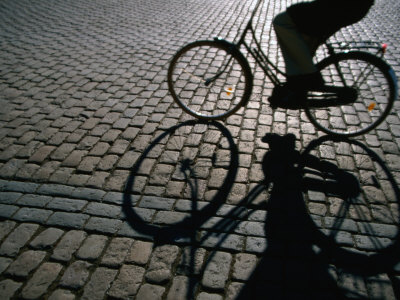 Shade of Cyclist Crossing Amalienborg Slotsplads, Copenhagen, Denmark Photographic Print by Martin Lladó
