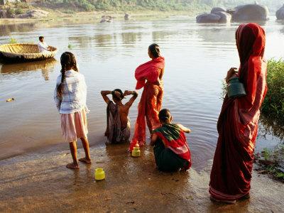 Females Washing in River in Morning, Hampi, Karnataka, India Photographic Print by Greg Elms
