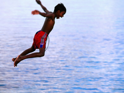 Boy Falling into Water, Lifou Island, Loyalty Islands, New Caledonia Photographic Print by Peter Hendrie