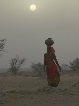 Woman Carrying Water Jar in Sand Storm, Thar Desert, Rajasthan, India Photographic Print by Keren Su