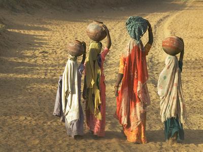 Girls Wearing Sari with Water Jars Walking in the Desert, Pushkar, Rajasthan, India Photographic Print by Keren Su