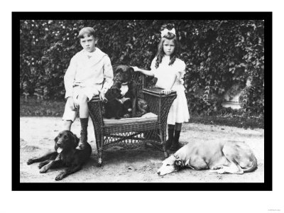 Boy and Girl with Their Four Dogs Print