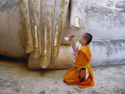 Novice Buddhist Monk Kneeling Beneath the Phra Atchana Buddha Statue, Sukhothai Province, Thailand Photographic Print