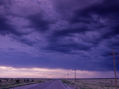 Car Traveling Down the Highway, New Mexico Photographic Print by Kenneth Garrett