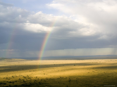 Rainbows Form over the Serengeti Plains, Tanzania Photographic Print by Michael Fay