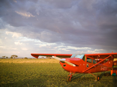 The Cessna Makes a Pit Stop to Refuel on the Serengeti, Tanzania Photographic Print by Michael Fay