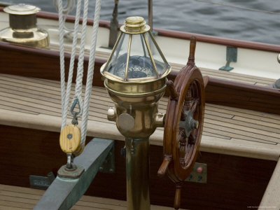 Ship's Wheel and Compass at the Helm of a Wooden Sailboat, Mystic, Connecticut Photographic Print by Todd Gipstein