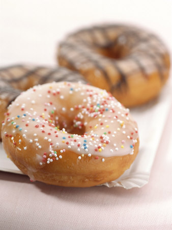 Doughnuts with Sugar Pearls and with Chocolate Icing Photographic Print by Alexander Feig