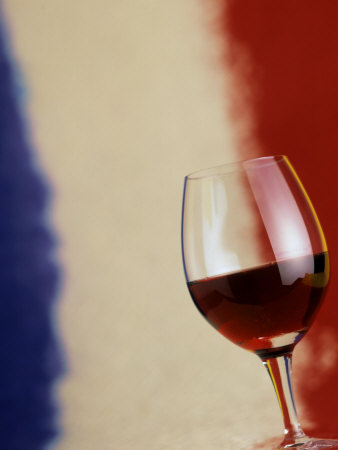 A Glass of Red Wine in Front of the French Flag Photographic Print by Steven Morris
