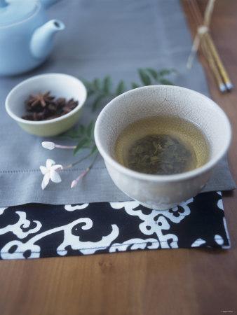 Chai Tea in Tea Bowl, Star Anise Behind Photographic Print by Deirdre Rooney