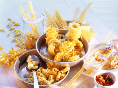 Lots of Different Types of Pasta in Dishes, Tomato Sauce Fotografisk tryk af Ulrike Holsten