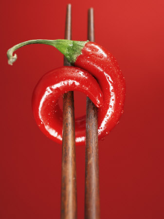 A Chili on Chopsticks Photographic Print